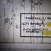 Felirat a terem falán: ellenállás = 3,1 ohm, ellenőrzés dátuma: 1989. május 25., következő ellenőrzés dátuma: 1989...