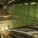 A Bocskai úti metrómegállóban szinte láttam magam előtt az építészt, amint alsónadrágban, izzadtan ül a tervezőszoftvere előtt, és miközben átkozza a sorsot, hogy más bezzeg nyaral a kánikulában, vonalakat húzkod a képernyőre. És lassan kirajzolódik Újbuda megállójának körvonala. Elképzelhetetlen más élethelyzet, amelyben ehhez az állomástervhez ihletet kap az ember.Földes András cikke az állomásról