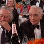 Robert DeNiro reakciója arra a viccre, amiben Gervais értetlenkedik, hogy mit keresne Scorsese egy vidámparkan, hiszen túl alacsony ahhoz, hogy  bármire is felüljön