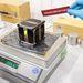 2011. október 25. Noordwijk, Hollandia. A Masat-1 repülő példánya megfelel a CubeSat szabvány 1 kg-os súlyhatárának (mérés az ESA Noordwijk-i tesztközpontjában).