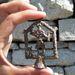 Silvanus isten apró ólomszobrocskája
