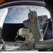 2011. március 2. Kilátás az ISS egyik moduljából a Discovery-re. Az űrsikló távirányítású rakodókarja munka közben.